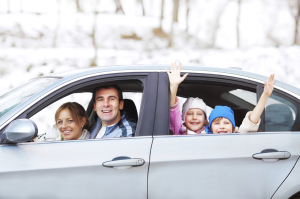 [cml_media_alt id='3402']Happy family driving in the car surrounded by snow.[/cml_media_alt]